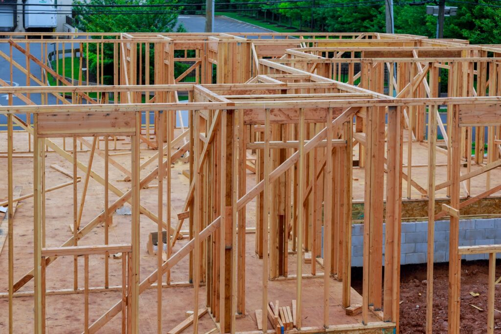 Abstract of Wood Home Framing at Construction Site. Building frame structure on a new development